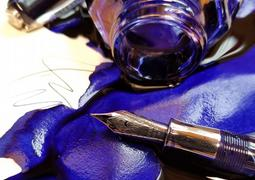 Blue ink with a pen