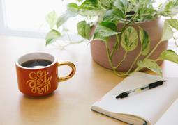 positive mug on desk